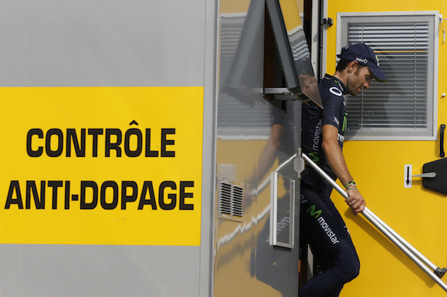 Spain's Alejandro Valverde leaves the anti-doping control bus at the end of the 32 km individual time-trial and seventeenth stage of the 100th edition of the Tour de France cycling race on July 17, 2013 between Embrun and Chorges, southeastern France. AFP PHOTO / PASCAL GUYOT / AFP PHOTO / PASCAL GUYOT